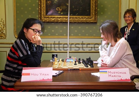 LVIV, UKRAINE - MARCH 11, 2016: 7th game of FIDE Women's World Chess Championship Match between Mariya Muzychuk (Ukraine) and Hou Yifan (China) in Potocki Palace, Lviv, Ukraine