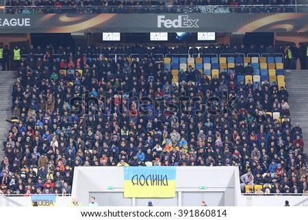 LVIV, UKRAINE - March 10, 2016: Tribunes of Arena Lviv stadium during UEFA Europa League Round of 16 game FC Shakhtar Donetsk vs RSC Anderlecht, Lviv, Ukraine - stock photo