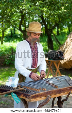 LVIV, UKRAINE - MAY, 22, 2016: Amazing street musician plays old stringed instrument. Street music.
