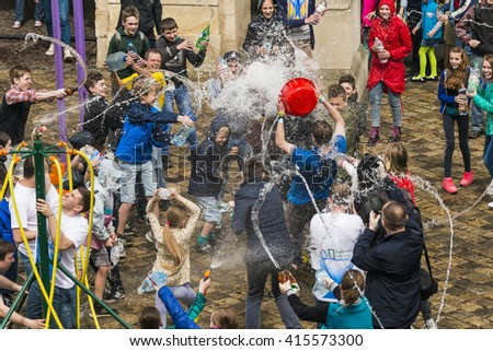 Lviv, Ukraine - 2 May 2016: Celebration pouring water on Monday after Easter by the town hall. Townspeople pour water Lviv mayor.
