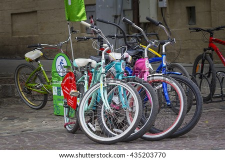 LVIV, UKRAINE - MAY 08, 2016: Different colorful bikes for rent in the center of Lviv in Ukraine - stock photo