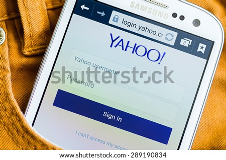 LVIV, UKRAINE - May 19, 2015: white Samsung Smart Phone with Yahoo Log In Screen  in the pocket of orange jeans - stock photo