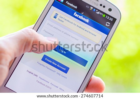 LVIV, UKRAINE - May 03, 2015: White Smart Phone with Facebook Social Network Log In Screen - stock photo