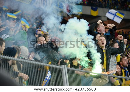 LVIV, UKRAINE - NOV 14: Ultras with smoke bombs in the stands during the match of play-off UEFA EURO 2016 national team of Ukraine vs Slovenia, 14 November 2015, Arena Lviv, Lviv, Ukraine