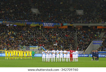 LVIV, UKRAINE - NOVEMBER 14, 2015: Minute of silence to pay tribute to victims of attacks in Paris during UEFA EURO 2016 Play-off for Final Tournament game between Ukraine and Slovenia at Lviv Arena - stock photo