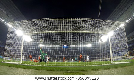 LVIV, UKRAINE - NOVEMBER 25, 2015: Real Madrid players (in White) score a goal during UEFA Champions League game against FC Shakhtar Donetsk at Arena Lviv stadium (GoPro camera behind the net)