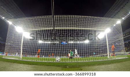 LVIV, UKRAINE - NOVEMBER 25, 2015: Real Madrid players (in White) score a goal during UEFA Champions League game against FC Shakhtar Donetsk at Arena Lviv stadium (GoPro camera behind the net) - stock photo