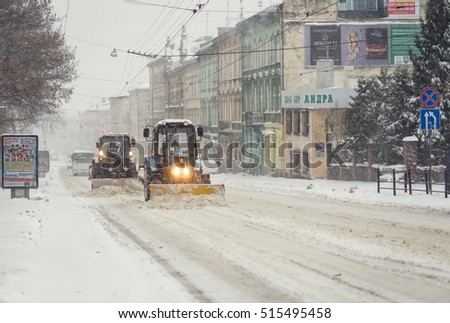 Lviv, Ukraine - November 13, 2016: snow-covered street in Lviv. Snow machines clean streets.