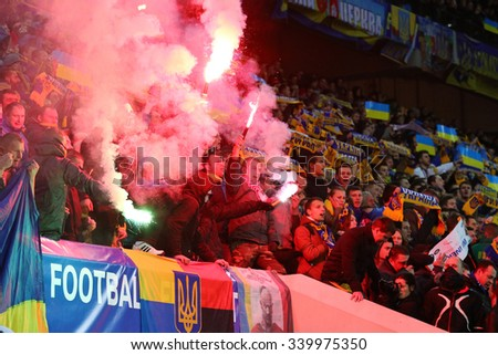 LVIV, UKRAINE - NOVEMBER 14, 2015: Ukrainian ultra supporters (ultras) burn flares during UEFA EURO 2016 Play-off for Final Tournament game between Ukraine and Slovenia at Lviv Arena - stock photo