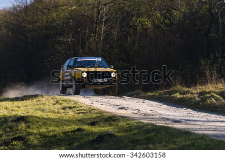 Lviv, Ukraine - November 1, 2015: Unknown racers on the car brand Volkswagen Golf overcome the track at the annual Rally of Galicia, near the city of Lviv, Ukraine - stock photo