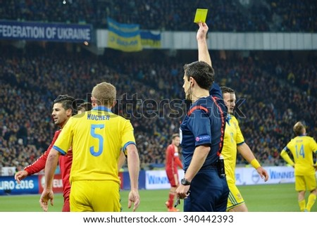 LVIV, UKRAINE - OCT 12: The referee Milorad Mazic shows a yellow card during the UEFA EURO 2016 qualifying match national team of Ukraine vs Spain, 12 October 2015, Olympic NSC, Kiev, Ukraine