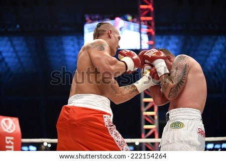 Lviv, UKRAINE -October 4, 2014 :  Oleksandr Usyk (Ukraine) and South African Daniel Bruwer in the ring during fight for WBO Inter-Continental cruiserweight title in the Arena Lviv Stadium