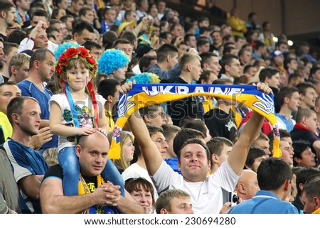 LVIV, UKRAINE - OCTOBER 12, 2014: Ukrainian fans support their team during the UEFA EURO 2016 Qualifying game between Ukraine and Macedonia on Lviv Arena - stock photo