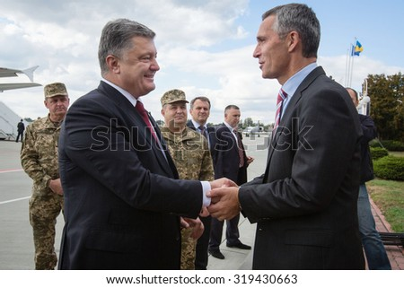 "LVIV, UKRAINE - Sep 21, 2015: President of Ukraine Petro Poroshenko and NATO Secretary General Jens Stoltenberg during a visit to the teachings of the Ukraine-NATO disaster relief ""Ukraine-2015"""