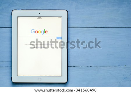 LVIV, UKRAINE - Sept 17, 2015: Google search home page on a white ipad screen - stock photo