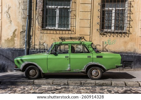 LVOV, UKRAINE - AUGUST 23:  Classic green Russian car in an old quarter on August 23, 2013 in Lvov. - stock photo