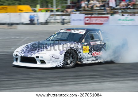 Lvov, Ukraine - June 7, 2015: Unknown riders on the car brand Nissan and BMW overcomes the track in the championship of Ukraine drifting in Lvov, Ukraine