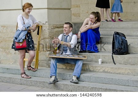 LVOV, UKRAINE - MAY 11:  Attraction - divination on cards, in the center of the city of Lviv, during the celebration of the city on May 11, 2013 in Lviv, Ukraine