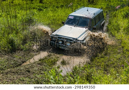 Lvov, Ukraine - May 30, 2015: Off-road vehicle Nissan Patrol overcomes the track on of landfill near the city Lvov. - stock photo