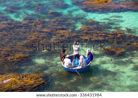 LY SON ISLAND-QUANG NGAI-VIETNAM. APRIL 26,2014. A view of fisher men on round boat in LY SON ISLAND - QUANG NGAI-VIETNAM