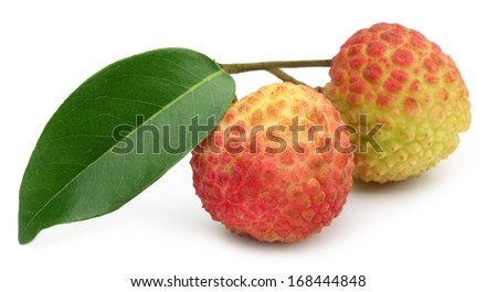 Lychee with green leaf over white background - stock photo