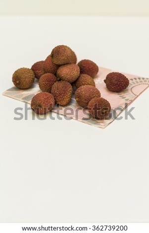 Lychees on a napkin, on the white background.