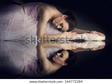 Lying ballerina, reflection on the mirror