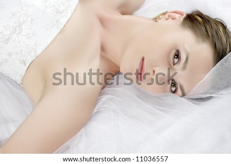 lying beauty bride in white dress