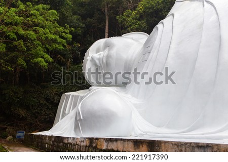 Lying Buddah statue in Ta Cu mountain, Binh Thuan province, Vietnam. This is the biggest lying Buddha statue in South East Asia. - stock photo
