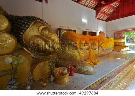 Lying Buddha gilded statue at Wat Phra Singh temple - Chiang Mai, Thailand - stock photo