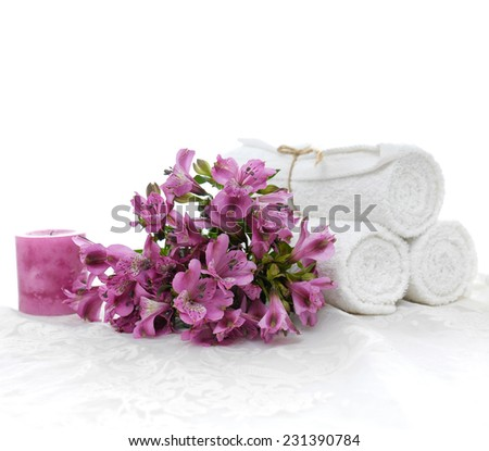 Lying down beautiful orchid and three roller towel with candle white lace  - stock photo