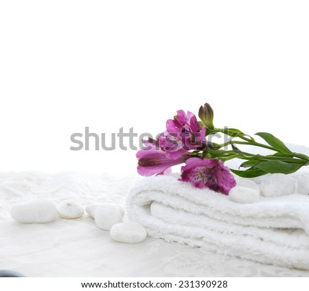 Lying down orchid in towel with white stones and white lace  - stock photo