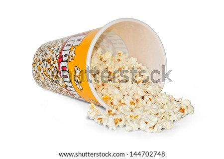 lying glass full with popcorn of corn - stock photo