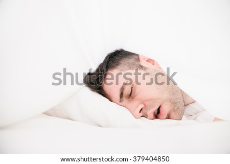 Lying in the sheets  - stock photo