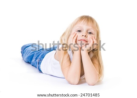 lying little girl in white top and blue jeans