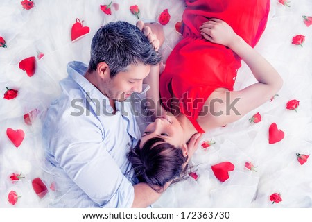 lying lovers couple in romantic scene - stock photo
