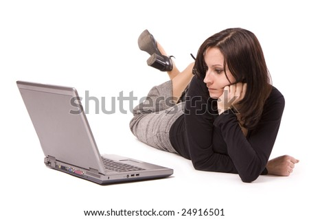 lying on floor from crossed legs businesswoman looking on laptop's screen
