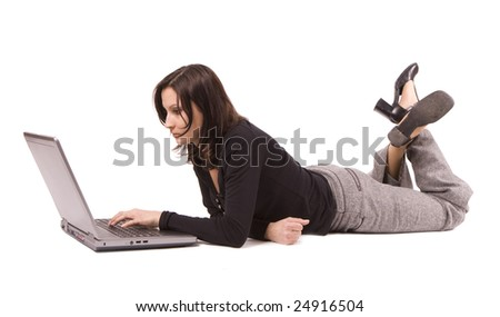 lying on floor from crossed legs businesswoman writing on laptop
