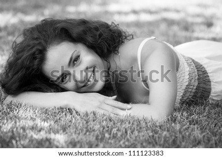lying on the grass in thr park in natural environment