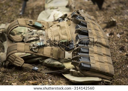 Lying tactical vest on the ground with holders - stock photo