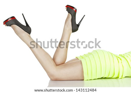 Lying woman in shoes, isolated on white background - stock photo