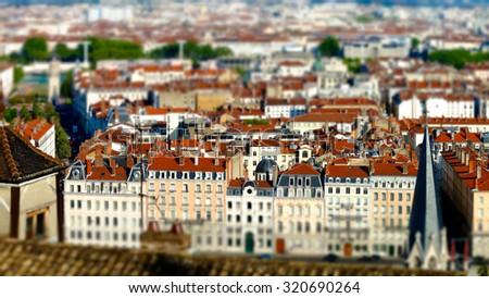 Lyon city bird-fly view in tilt-shift, France, tourism concept - stock photo