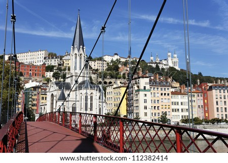 Lyon city with red footbridge on Saone river - stock photo