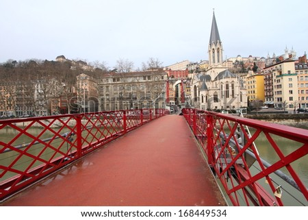 Lyon cityscape from the red bridge on Saone river, France  - stock photo
