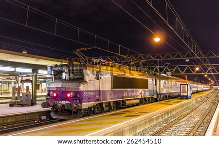 LYON, FRANCE - JANUARY 07: Electric locomotive with a regional train on January 7, 2014 at Lyon Part-Dieu railway station. The station was constructed in 1978 as part of the Part-Dieu urban project - stock photo