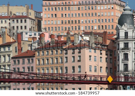 LYON, FRANCE, MARCH 16, 2014 : First sunny days of spring on Saone river banks. Together with its suburbs and satellite towns, Lyon forms the largest conurbation in France outside Paris.