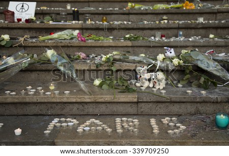 LYON-FRANCE NOVEMBER 15, 2015:  Offerings, toughts, flowers and candles on the steps of the town hall at Lyon, France about the terrorist bombing happens in France on 13th november 2015. - stock photo
