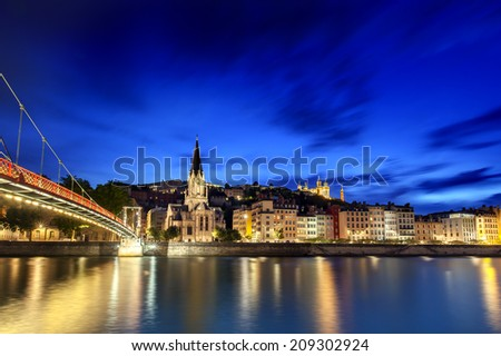 Lyon, France, viewed at night across the Saone River. - stock photo