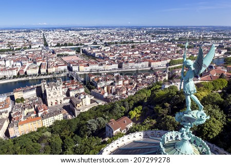 Lyon, France, viewed from the top of Notre Dame de Fourviere, with statue of St George. Mont Blanc is visible on horizon. - stock photo