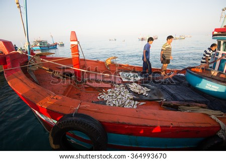LYSON, VIETNAM - JANUARY 4, 2016: Fisher men on the boat after journey in Ly Son island in Quang Ngai, Vietnam.